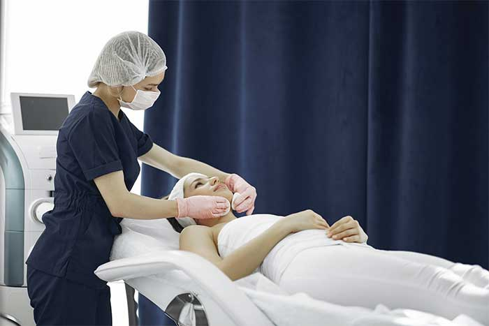 Spa attendant with patient